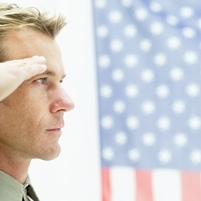 side profile of man saluting the American flag