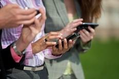 Three Businesswomen Texting