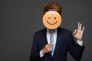 Winky face emoji businessman